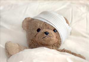 Photo of a teddy bear with bandage