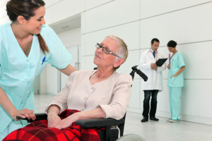 018068555_Nurse talking to an elderly woman in a wheelchair